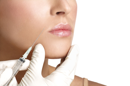 beauty woman close up injecting botox on white